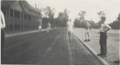 vintage runners on track blurry running