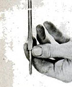 Vintage man holding a screwdriver in hand.