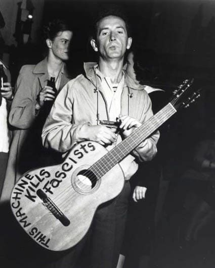 woody guthrie with guitar machine kills fascists