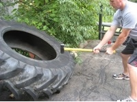 strongman odd object strength training lifting tires
