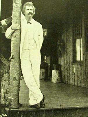 Mark Twain standing on deck.