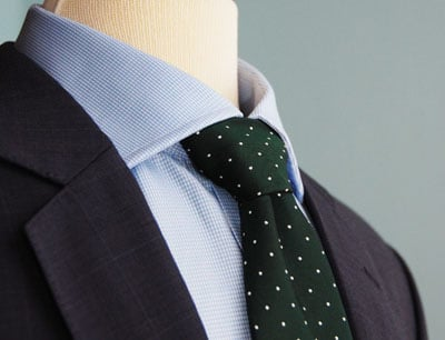 Blue blazer green polka dot tie.