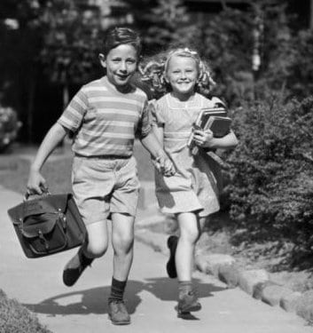 vintage 1950s young kids running home from school