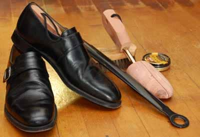 Monk strap dress shoe with tree horn brush.