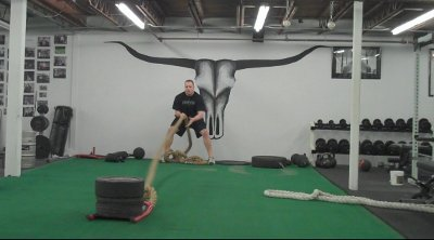 Heavy rope rows fitness routine training.