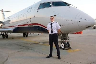mark maxwell airline pilot in front of airplane
