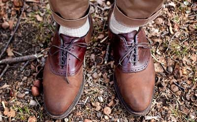 brown Saddle Shoes on feet rocky ground