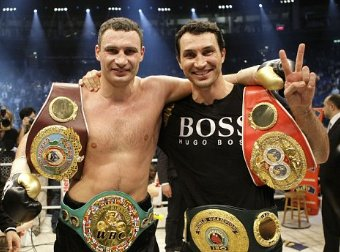 The Klitschko Brothers with heavyweight boxing belts.