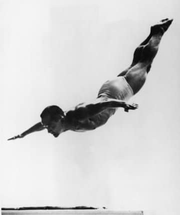 Sammy Lee Olympic diver action while doing swan dive.