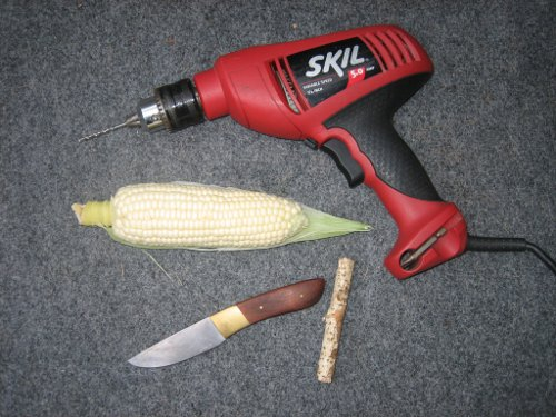 DIYof corn cob pipe supplies like drill, knife,corn cob and stick.