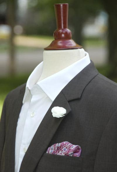 Jacket with pocket square and boutonniere.