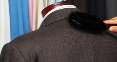 Brushing,caring and cleaning of men suit jacket for wardrobe.