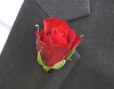 Red rose boutonniere.