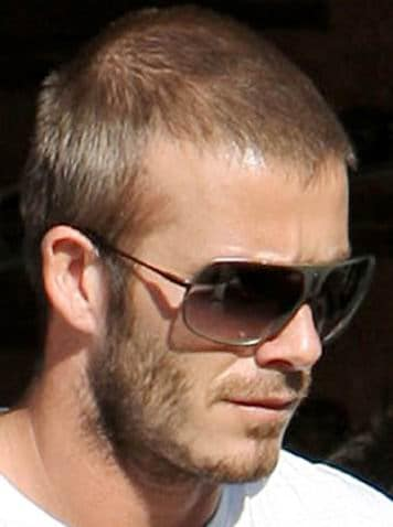 David beckham with sun glasses and short hair.