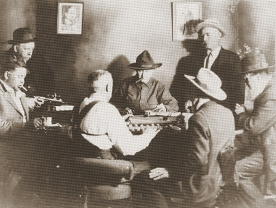vintage men cowboys playing poker smoking cigars