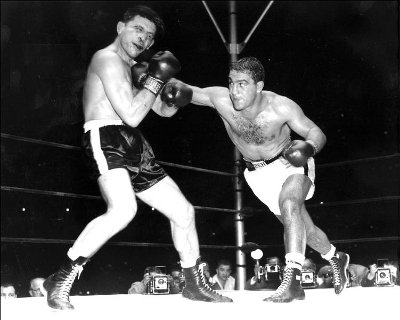 rocky marciano boxing throwing jab at opponent