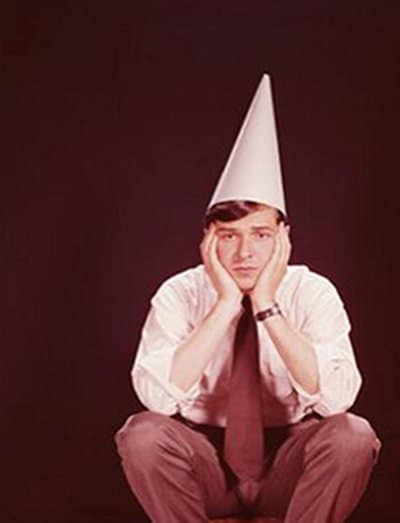vintage man in dunce cap squatting 1960s 1970s