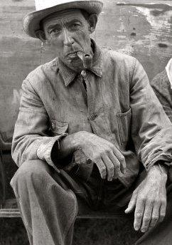 vintage farmer smoking corn cob tobacco pipe