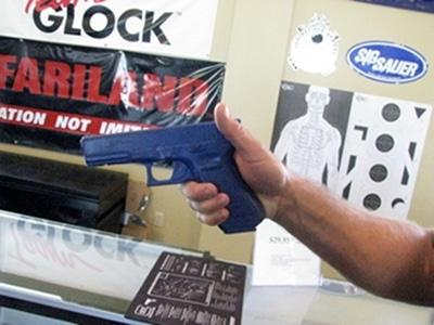 A man holding short gun safely.