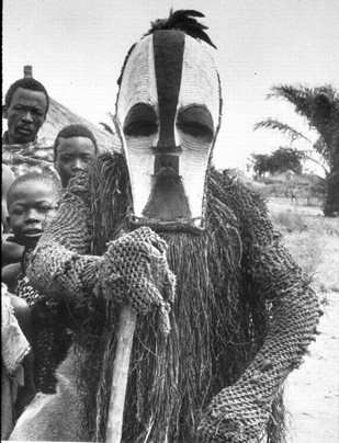 vintage african man wearing decorative mask on head