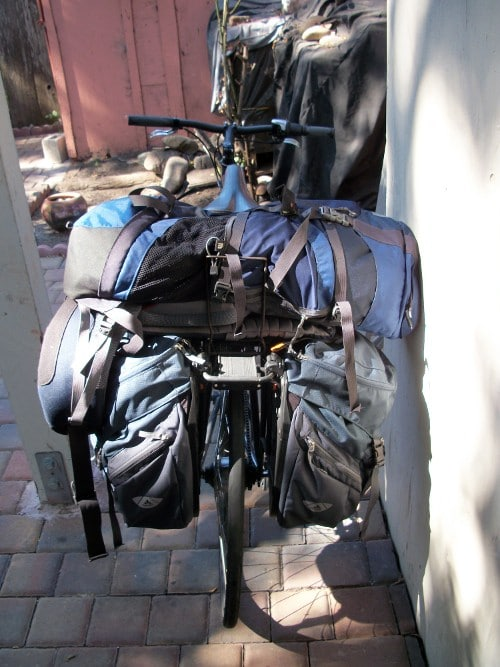Survival bags are lifted with hauling rack of bicycle.