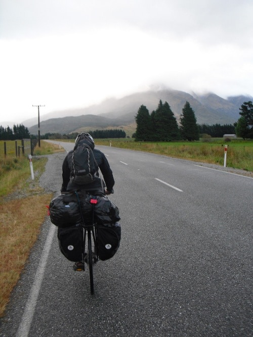 bike rider on highway in valleys mountains