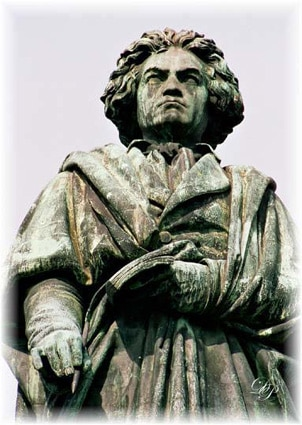 Beethoven statue of holding pocking notebook and pen.