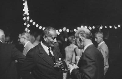 vintage two older men talking at party cocktails