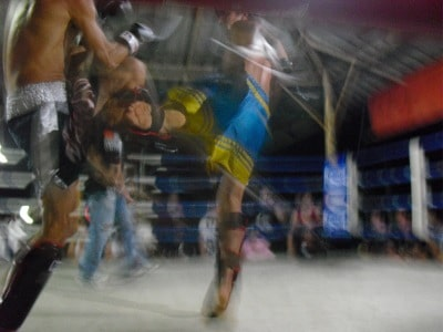 muy thai fight blurry fighters in ring kicking