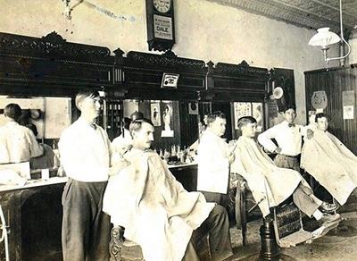 vintage barbershop men getting haircut early 1900s