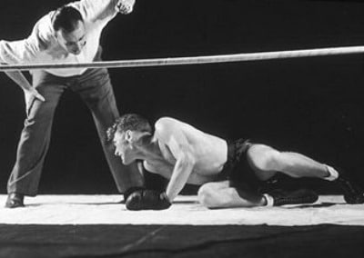 vintage boxer in ring getting up knocked down