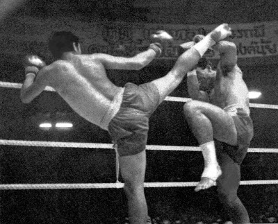 vintage muy thai fighters in ring kicking