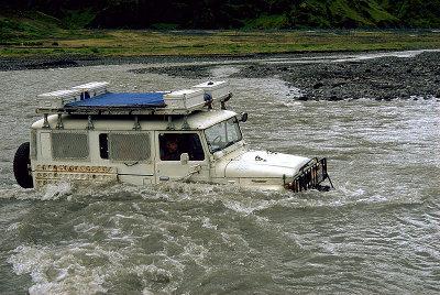 Toyota land cruiser in river.