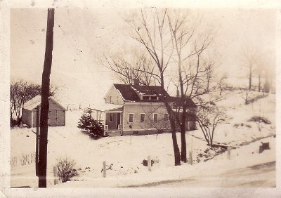 vintage country home and garage in winter