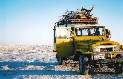 toyota land cruiser yellow in white desert