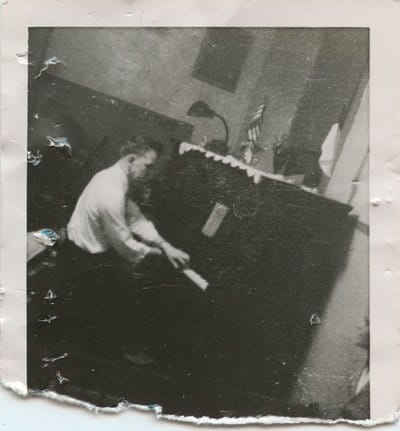vintage man playing piano old crumpled photo