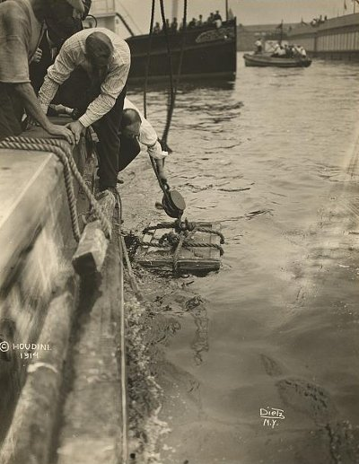 Harry Houdini lowered into New York Harbor, July 7, 1912.