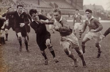 vintage rugby match game players running