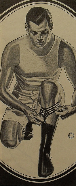 Man putting on garters while getting ready.