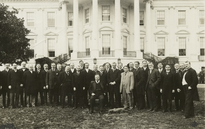 Theodore Roosevelt and the Tennis Cabinet in front of white house.