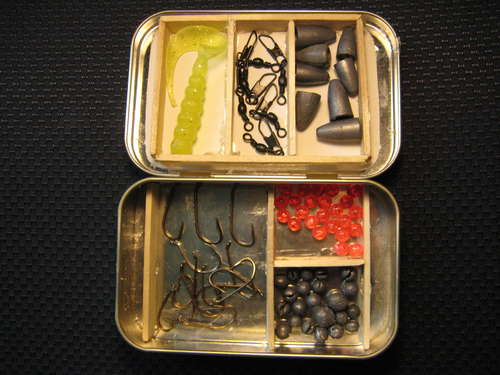 Altoids tin using for fishing tackle box.