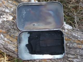 Altoids tin using for charcloth maker.
