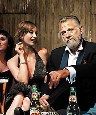 Most interesting man in the world Dos Equis drinking beer.