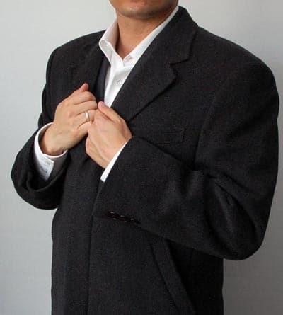 Man wearing grey overcoat.