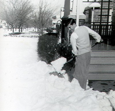Vintage man shoveling the snow.
