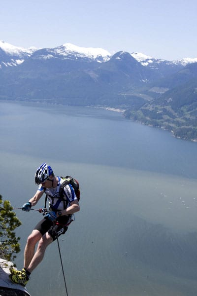 adventure racing in mountains lake rappelling cliff