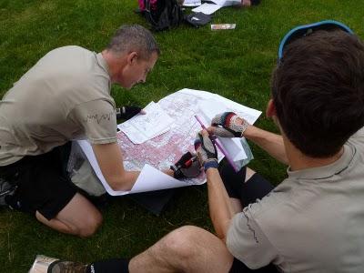adventure race racing looking at map navigating
