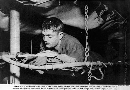 military GI reading book in bunk