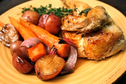 Roasted chicken and veggies in the plate.