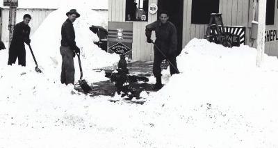 vintage group of men shoveling snow driveway walk